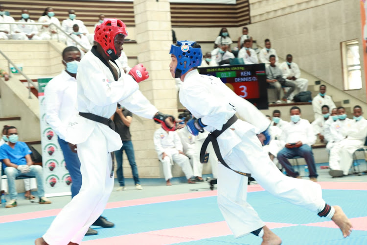 Kenya's Denis Oyugi (L) duels with Philippine's Jonel Salve during the 8th Mombasa Open Tong-IL-Moo do Championship at Aga Khan Academy Hall Mombasa on December 21.