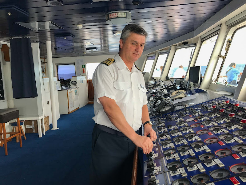 Wind Surf Capt. Pedro Pinto checks navigation settings on the ship's bridge.