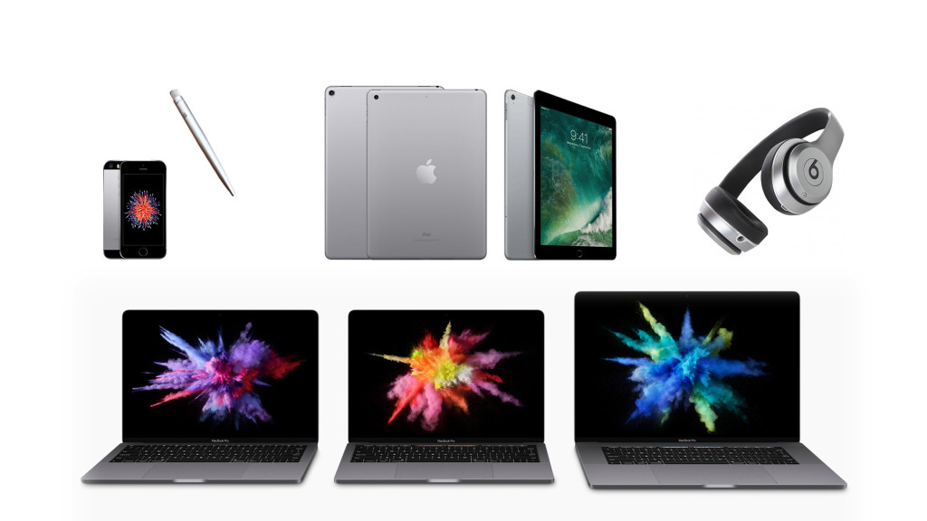 A collection of Apple devices, such as iPhones, iPads, Beats headphones, and Macbook Pro laptops.