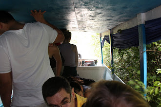 Photo: Year 2 Day 41 -  Everyone Standing in the Middle of the Boat to Avoid Being Hit by Vegetation