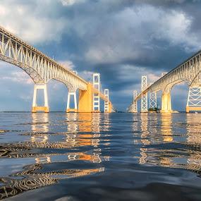 Storm at the Bridge by Carol Ward - Buildings & Architecture Bridges & Suspended Structures ( annapolis, chesapeake bay bridge, between the bridge spans, maryland, reflections, chesapeake bay, architecture, storm clouds, bridge, storm, beneath,  )