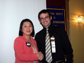 Photo: Lan Chi Nguyen Weekes is congratulated for becoming Chair of the Indoor Environmental Quality Committee for the American Industrial Hygiene Association (the first Canadian to hold this position) by Robert Lefebvre