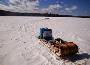 Photo: I didn't take my snowmobile out - it was too risky to deal with the consequences of getting stuck - so I drilled a hole with Robin's auger and phauled the water tanks back to camp.,