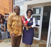 Minister Siyabonga Cwele pays a special visit to Scottburgh home affairs official Nosipho Mkhupheka, who has been hailed as a hero for her hard work.
