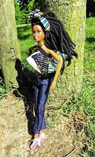 Doll with locks affirm Africans.