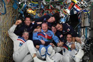 Astronauts on the International Space Station celebrate the olympics