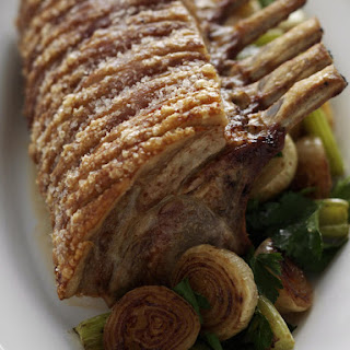 Crispy Pork Roast with Applesauce and Roasted Vegetables.