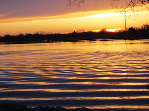 Photo: Purple and golden ripples in a lake at sunset at Eastwood Park in Dayton, Ohio.