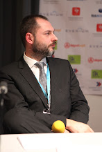 """Photo: Philippe Borremans - moderator: """"Chief Comms Officer's Role"""" Panel - 2012"""