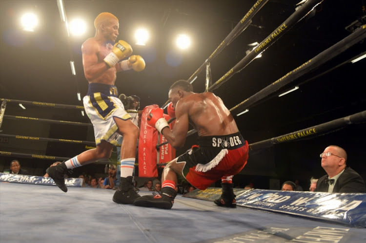 Azinga Fuzile knocks down Tshifhiwa Munyai during the Four go to War boxing bout at Emperors Palace on October 21, 2017 in Johannesburg, South Africa.