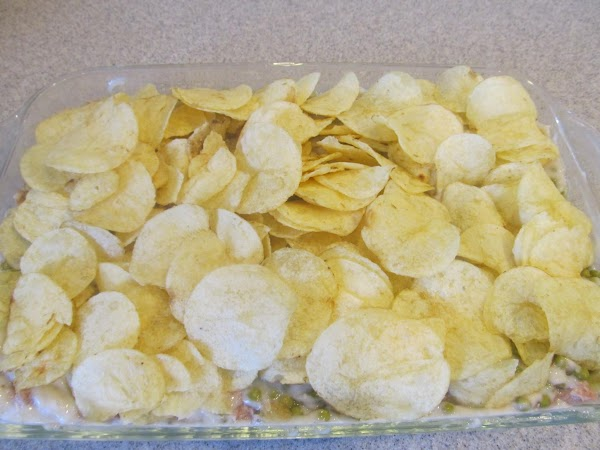 Layer the top with potatoe chips leaving the chips whole this time.  Place in the...