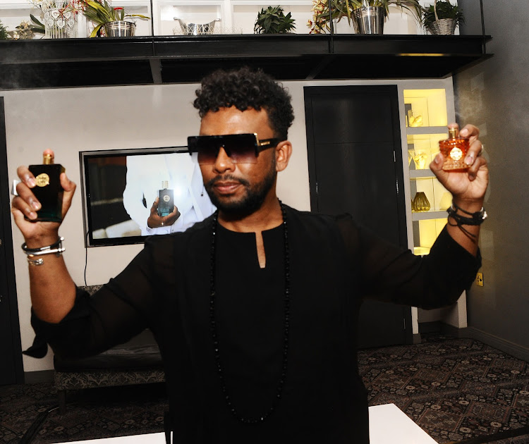 David Tlale shows off his newly launched fragrances, Exotic for Him (left) and Exotic for Her.