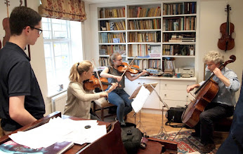 Photo: Sophie, Lizzie and Robert working with Hugo on his new composition