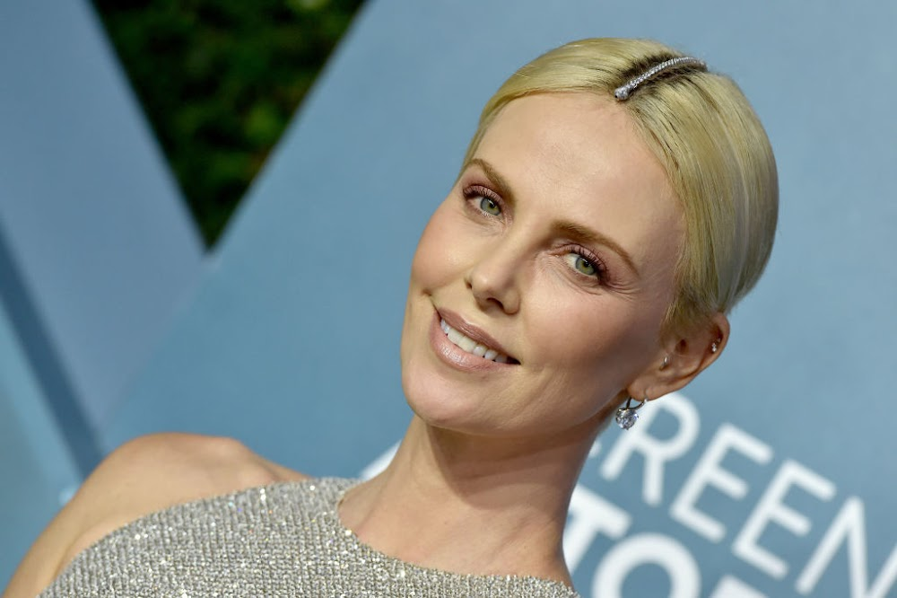 Charlize Theron dons R224,000 bracelet on her head to hide her roots - TimesLIVE