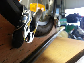 Photo: Close up of the snowboard bindings. We bought bolts that were not flat enough; (the strap slides along the bottom of the capture point) so be sure to get theflatnessof whatever you decide to use to attach the bindings to the board.
