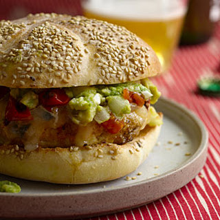 Chicken Burgers With Guacamole, Cheddar, and Charred Tomatoes.