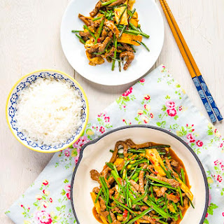 Stir Fried Beef with Thai Chive Flower and Bean Curd.