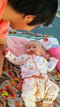 Photo: Arm admires baby Ploy (one month)