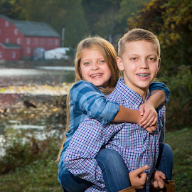 Siblings by the Mill by Dave Dabour - People Family ( lauren, 2016, fall, leaves, clinton, rick, brother, sister, mill, clinton red mill,  )