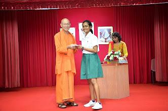 Photo: Miss Saranya (O level) receiving the Award from Swamiji