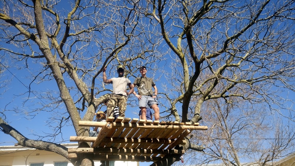Junior and André proudly having completed the flooring of the treehouse