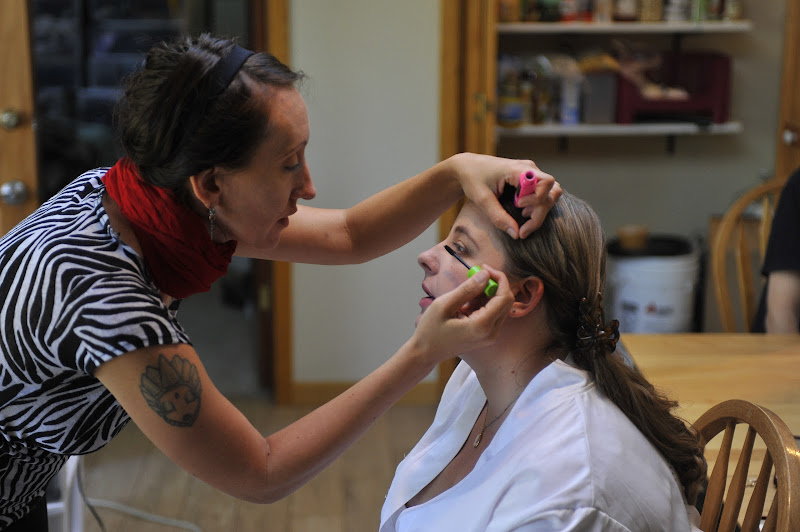 Photo: Tarena works on Kelly's makeup