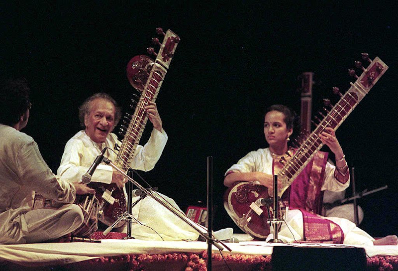 "Photo: BOMBAY, INDIA:  World renown sitar mestro Ravi Shankar (L) and his 18 year-old daughter Anoushka, perform at the Aalaap music festival in central Bombay  late 27 February.  Shankar was recently awarded the ""Bharat Ratna, ""  said he was happy to receive the prestigious award while he was still alive. (Photo credit should read SEBASTIAN D'SOUZA/AFP/Getty Images)"