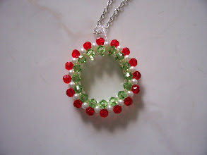 "Photo: Swarovski Crystal and Glass Pearl Chrestmas Wreath. Diameter: 1 3/8"" and the thickness: 5/16"" with a 18"" chain. Color: Siam light, Peridot and white Glass Pearl. $35.00 each."