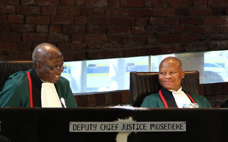 Deputy Judge President Dikgang Moseneke (L) and Chief Justice Mogoeng Mogoeng exchange smiles as Moseneke particiipates for the last time at the Constitutional Court. The session, on Friday, marked his formal  farewell from the court. Picture: GCIS