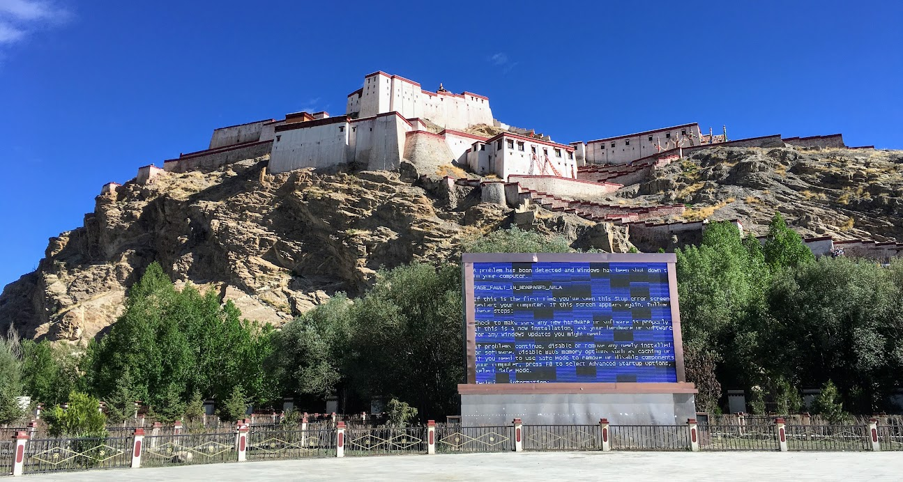 On our way back to Lhasa our guide gave an option, a visit to (yet) another monastery, or to hike up a fort. The whole group unanimously voted for the fort. We loved the view from this fort, but my favorite part is the giant screen at the front showing a Windows error message.