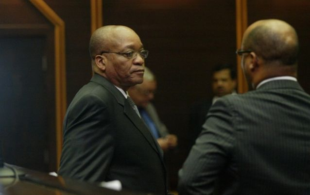 Jacob Zuma talks to his attorney Michael Hulley in the PMB High Court where they were apposing the state acquiring papers from Mauritius to build a case against him\nPic:: Jackie Clausen. 22/03/2007. © Sunday Times