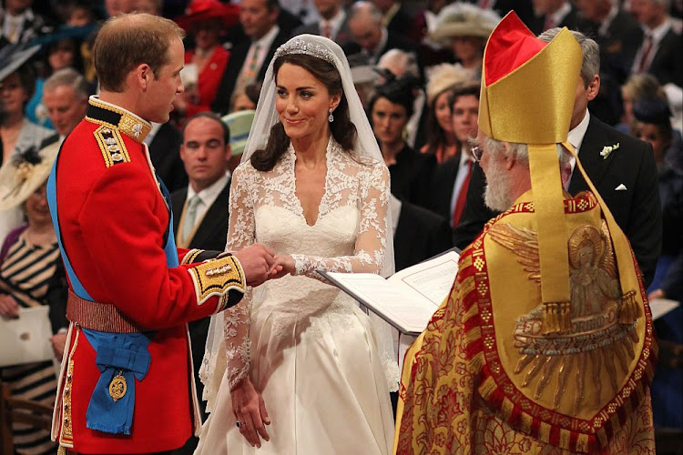 Prince William and Kate Middleton exchange rings in front of the Archbishop of Canterbury during their wedding at Westminster Abbey, on April 29, 2011 in London