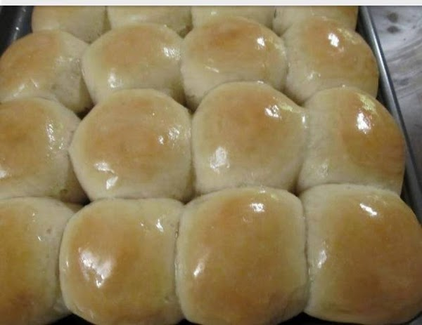 In a large bowl, mix together warm water, sugar, oil and yeast. Let stand...