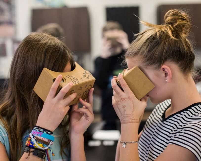 two girls using a Google Cardboard