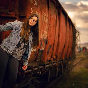 Escape  by Hurghis Vasile - People Portraits of Women ( clouds, life, color, still life, woman, train, travel, transportation, light, people, portrait )
