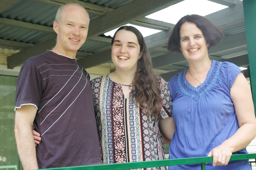 Hard work pays off: Sarah Nash, flanked by parents Greg and Susan, after receiving the news on Friday that she achieved an ATAR score of 92.85.