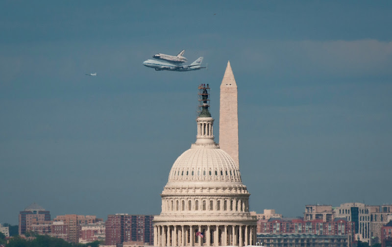 Photo: Space shuttle Discovery, mounted atop a NASA 747 Shuttle Carrier Aircraft (SCA) flies near the U.S. Capitol, Tuesday, April 17, 2012, in Washington. Discovery, the first orbiter retired from NASA's shuttle fleet, completed 39 missions, spent 365 days in space, orbited the Earth 5,830 times, and traveled 148,221,675 miles. NASA will transfer Discovery to the National Air and Space Museum to begin its new mission to commemorate past achievements in space and to educate and inspire future generations of explorers. Photo Credit: (NASA/Rebecca Roth)