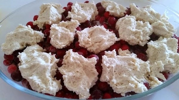 Now, add heaping dollops of batter evenly over the top of berries. I flatten...