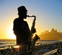 Photo: Music at sunset The sunset atmosphere in Ipanema beach is great in the summer... I liked the way the mountains' outline seems to be flowing out of his sax.