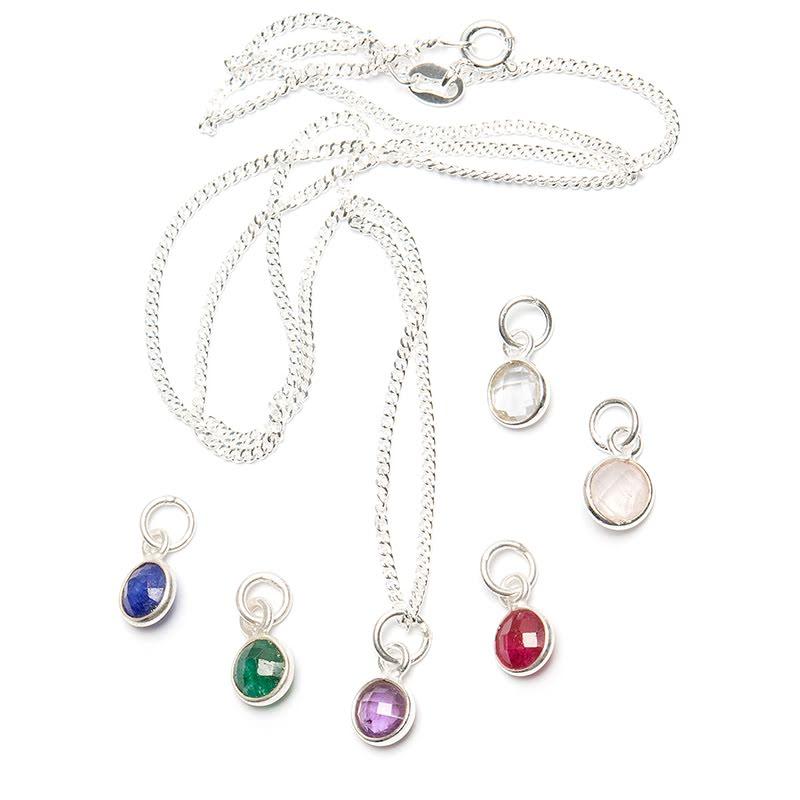 Kristallhänge, fasettslipat runt hänge i silverinfattning