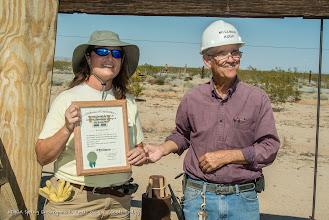 Photo: Christa Torres receives her Millman diploma from Executive Director Hugh Brown. (Scott Braley)