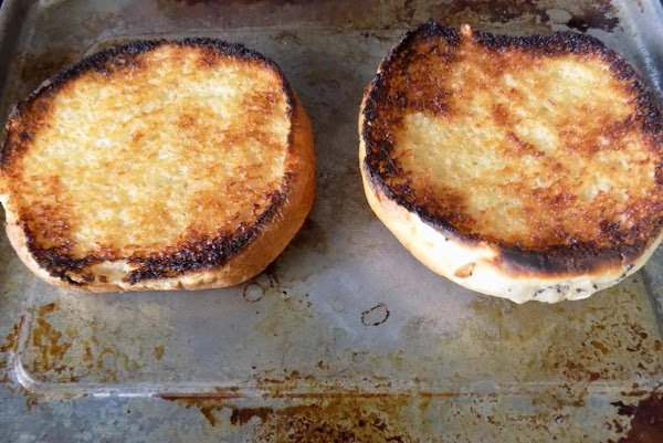 Butter the onion buns and put them under the broiler until browned. When buns...