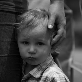 Close to Momma by Scott Morgan - Black & White Street & Candid ( hand, child, safe, b&w, black and white, scared, candid, head, boy,  )