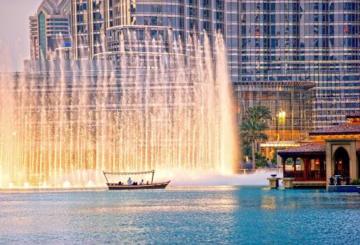 Take in the Dubai Fountain, the world's tallest performing fountain, in downtown Dubai.