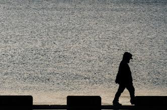 Photo: A man walks along the sea wall of Tokyo Bay at Sogokoen Park on January 1st, 2013