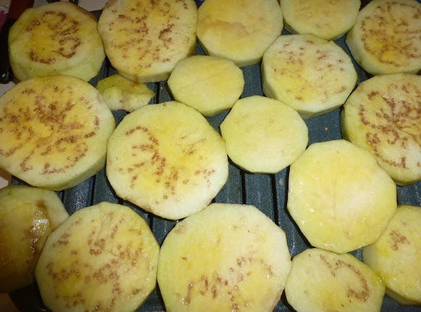 """Peel eggplants and cut into 3/4"""" slices. Arrange on a cookie sheet and spray..."""