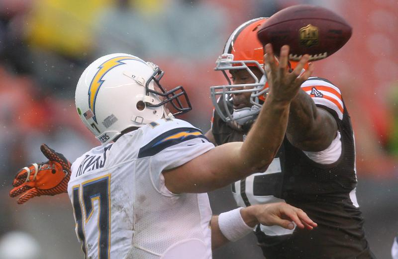 Photo: Browns defensive end Juqua Parker puts pressure on Chargers quarterback Philip Rivers in the fourth quarter. (Joshua Gunter, The Plain Dealer)