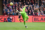 Bernd Leno of Arsenal dives for the ball as Jordan Ayew of Crystal Palace (out of frame) scores his team's first goal during the Premier League match between Crystal Palace and Arsenal FC at Selhurst Park on January 11, 2020 in London, United Kingdom.