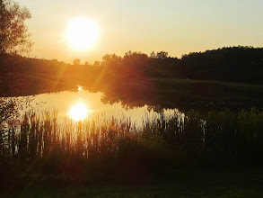 Photo: Bright sunlight as the sun sets on a golden lake at Carriage Hill Metropark in Dayton, Ohio.