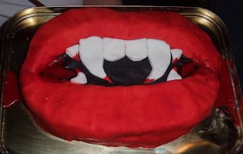 Photo: A vampire themed birthday cake, complete with blood icing